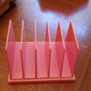 Kitsch pink plastic mail sorter